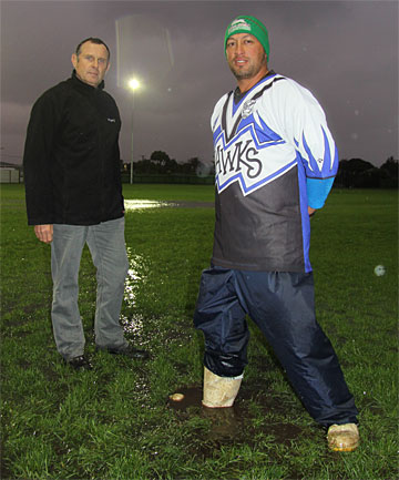 POTHOLED: Hawera Hawkes chairman Llew Kahui and Southern Rugby chairman Greg Worder stand on the 40 metre line of the Hub league field with Mr Kahui's foot disappearing into the hole left after a rock the size of a two-litre milk container was re