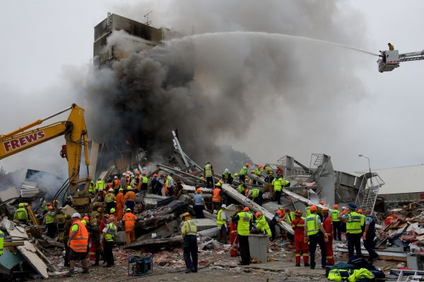 A sea of help, as rescue workers scour the smouldering remains of the CTV building.