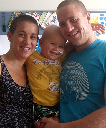 BLINDSIDED: Ryan and Keri Topperwien with Chace, who is battling a rare form of leukaemia.