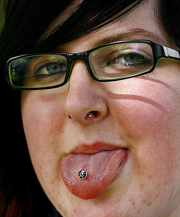 PIERCED UP: Taranaki secondary school student MJ Hodson, 15, with her pierced tongue, septum and double earrings including one stretcher, wants all secondary schools to allow facial piercings.