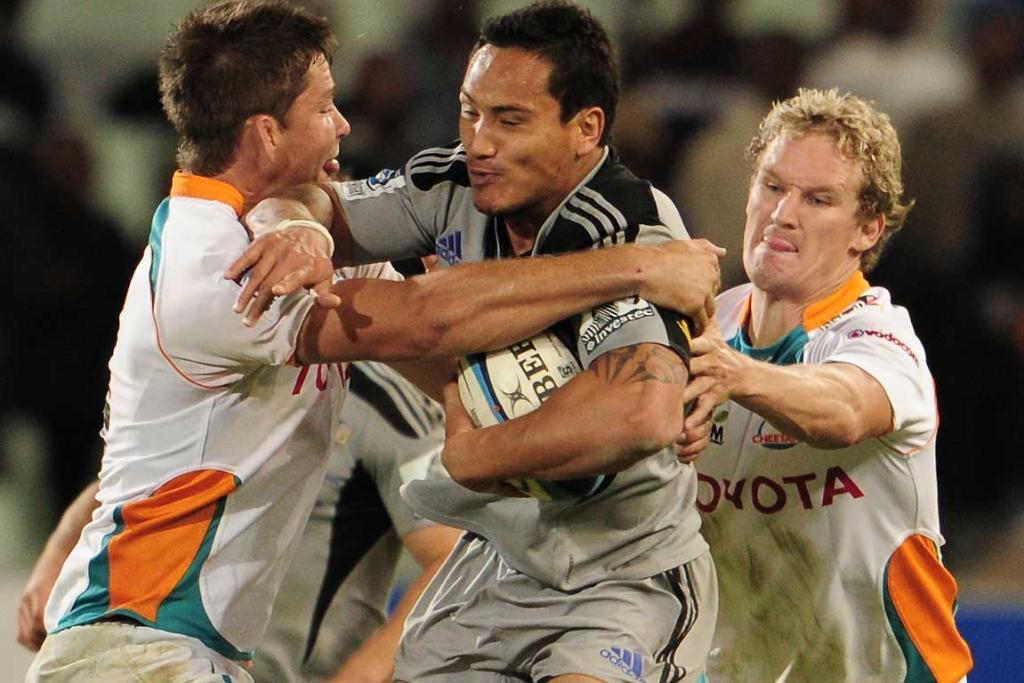Hosea Gear of the Hurricanes is tackled by Cheetahs' players.