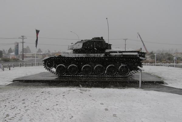 Snow falls at the National Army Museum in Waiourou, on State Highway 1.