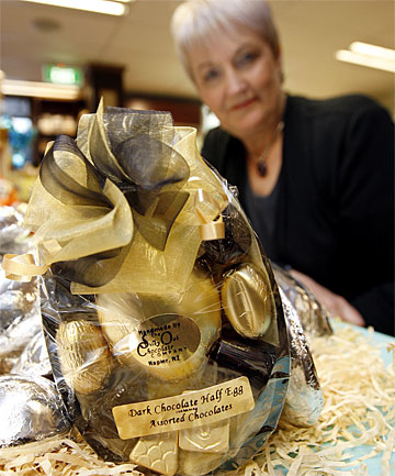 THE EGG IS HALF-FULL: Promotions manager Lyn Tait displays a  Silky Oak choc-filled half-egg at Kirkcaldie's confectionery shop.