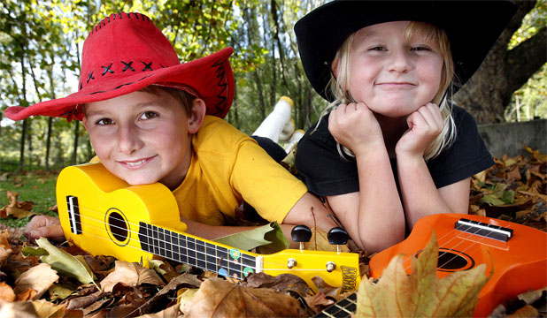 CUTE CAUSE: Uruti School's Calum Black, 10, and sister Ishbel Black, 7, with their ukuleles that might be the winning ticket to a $10,000 ukulele Hitachi competition that closes next week.
