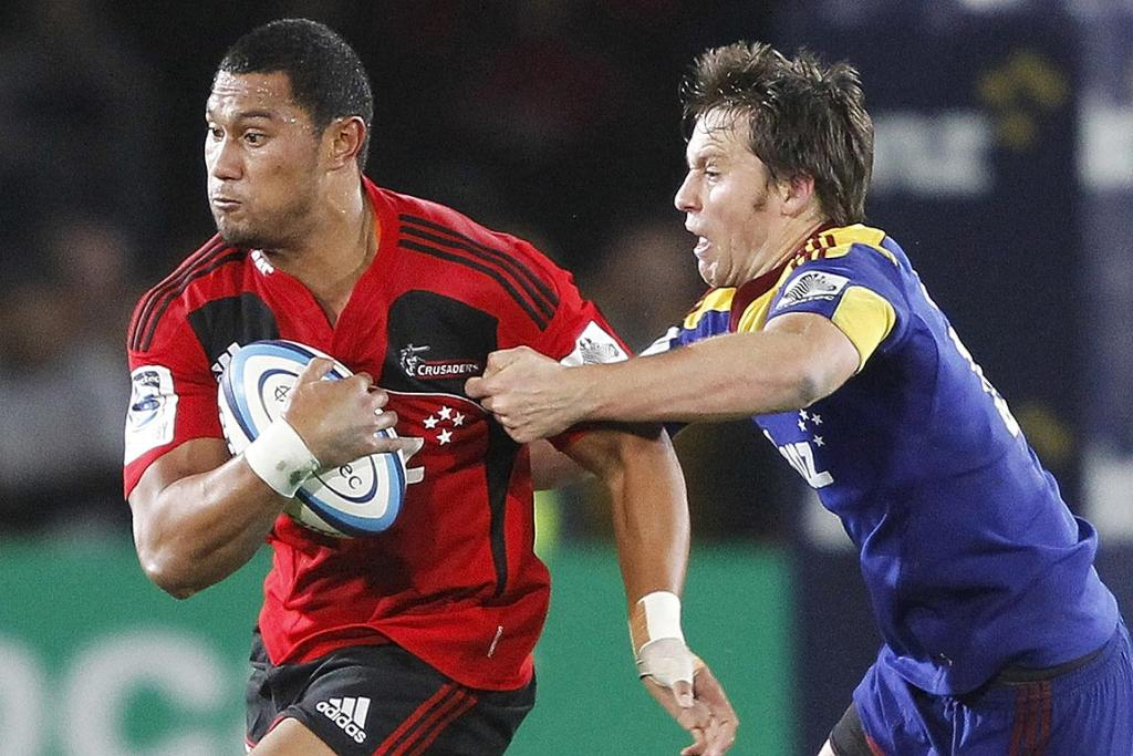 Robbie Fruean of the Crusaders breaks through the tackle of Shaun Treeby of the Highlanders during the round 10 Super Rugby match in Nelson.