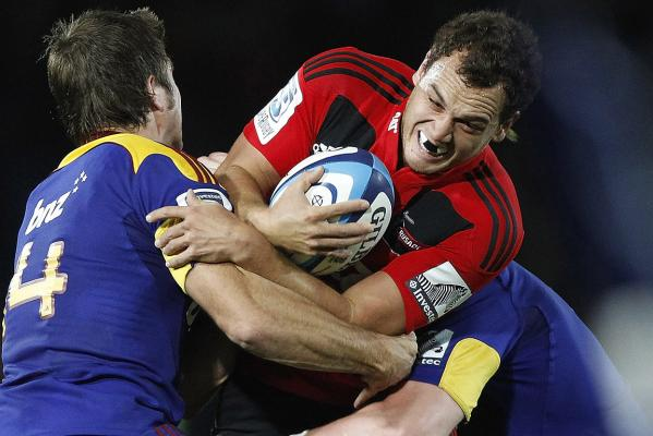 Crusaders back Israel Dagg is tackled by James Paterson of the Highlanders during the round 10 Super Rugby match at Trafalgar Park in Nelson.