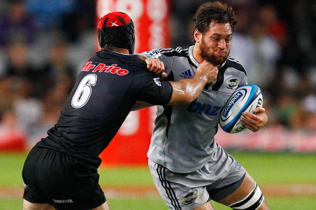Jack Lam of Hurricanes holds off Jacques Botes of Sharks.