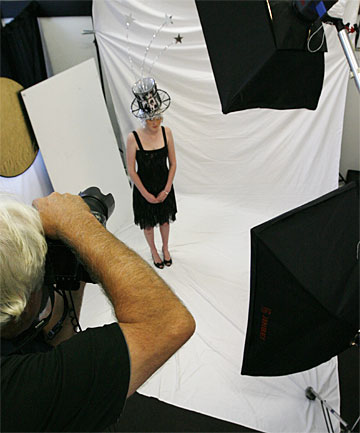 FINAL SHOT: John Slater photographs the models for the New Zealand Hat and Hair Art Awards tomorrow. The photos will appear on screen as the hat is displayed.