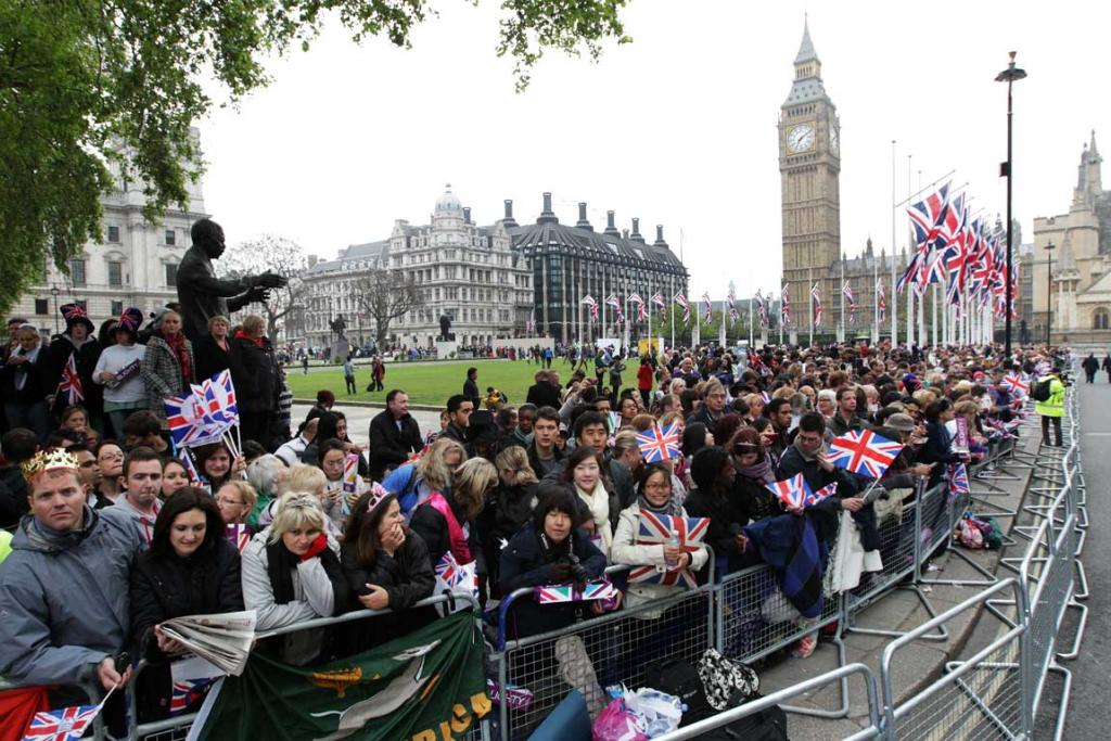 Well wishers line the route ahead of the Royal Wedding.
