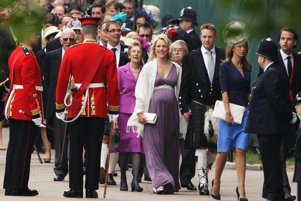 Guests arrive to attend the Royal Wedding.