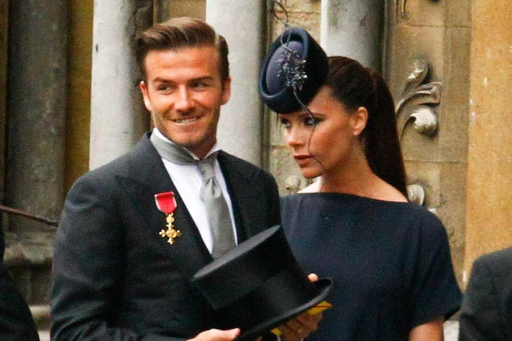 Soccer star David Beckham and his wife Victoria arrive at Westminster Abbey.