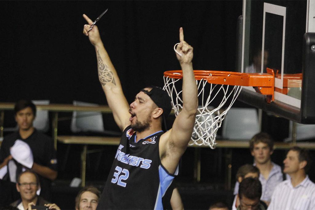 Breakers foundation player Paul Henare  celebrates victory over the Cairns Taipans.