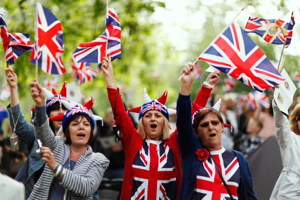 People wave flags in St James Park after the wedding of Britain's William, Duke of Cambridge and Catherine, Duchess of Cambridge.