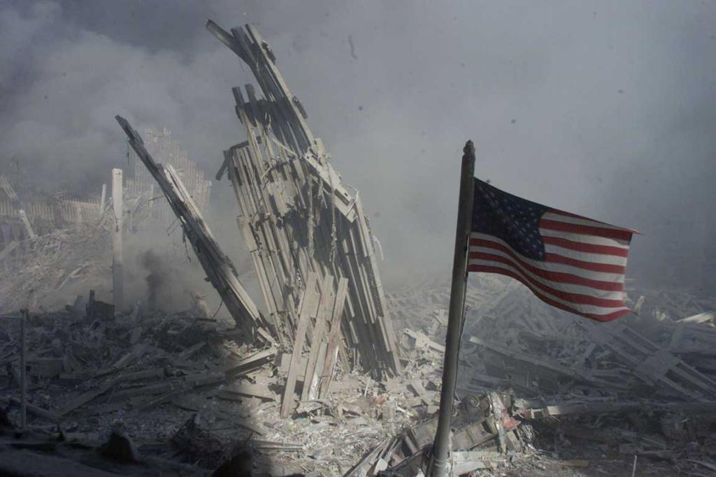 An American flag flies near the base of the destroyed World Trade Center in New York, in this file photo from September 11, 2001.