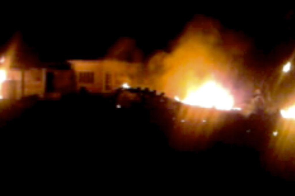 The compound, within which al Qaeda leader Osama bin Laden was killed, is seen in flames after it was attacked in Abbottabad in this still image taken from video footage from a mobile phone.