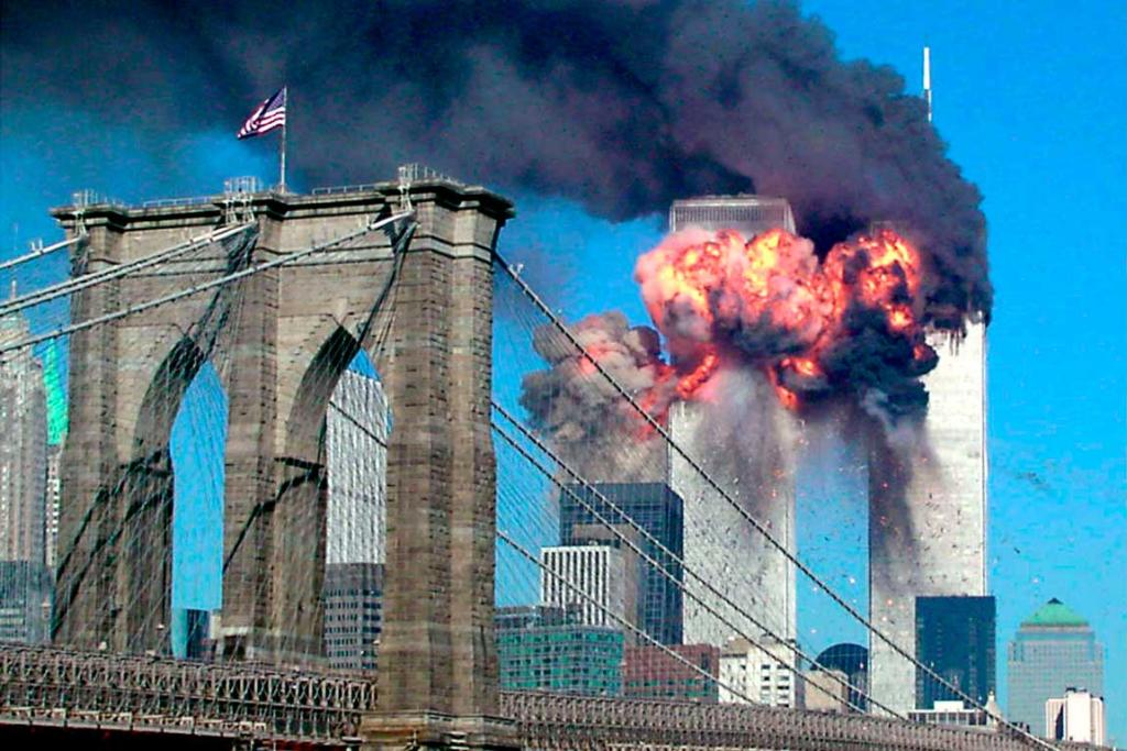 The second tower of the World Trade Center explodes into flames after being hit by an airplane.