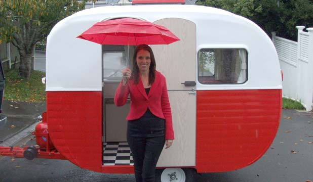 FULLY RESTORED: Jacinda Ardern with the fully restored caravan once owned by the Topp Twins.