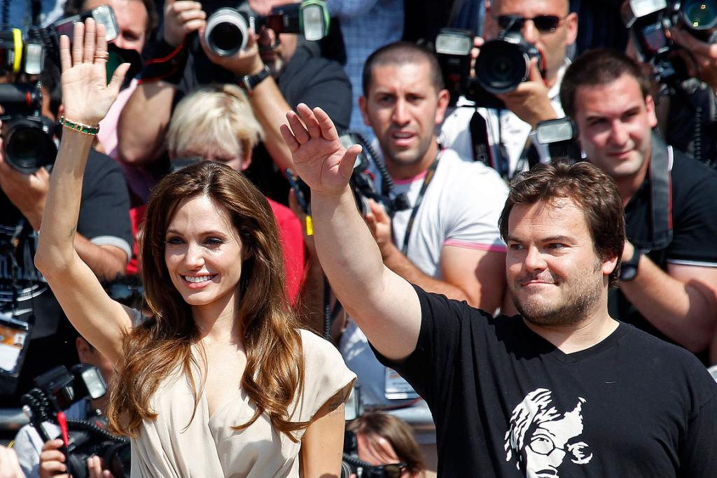 SALUTE THE KING: Angelina Jolie and Jack Black pose during a photocall for the animated film Kung Fu Panda 2 during the Cannes Film Festival.