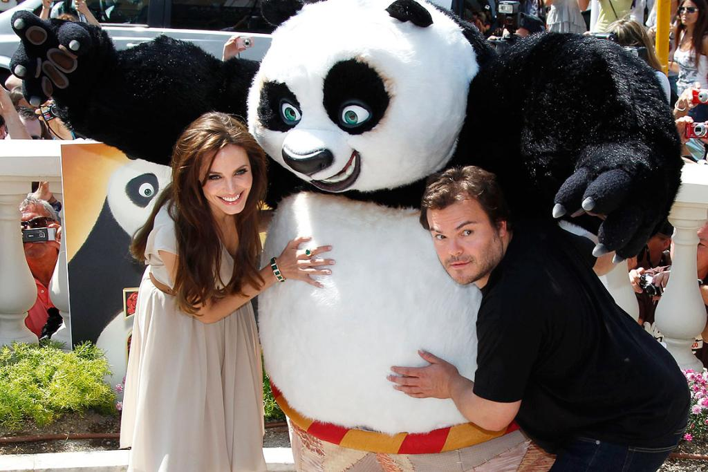 PANDA HUG: Angelina Jolie and Jack Black pose during a photocall for the animated film Kung Fu Panda 2 during the Cannes Film Festival.