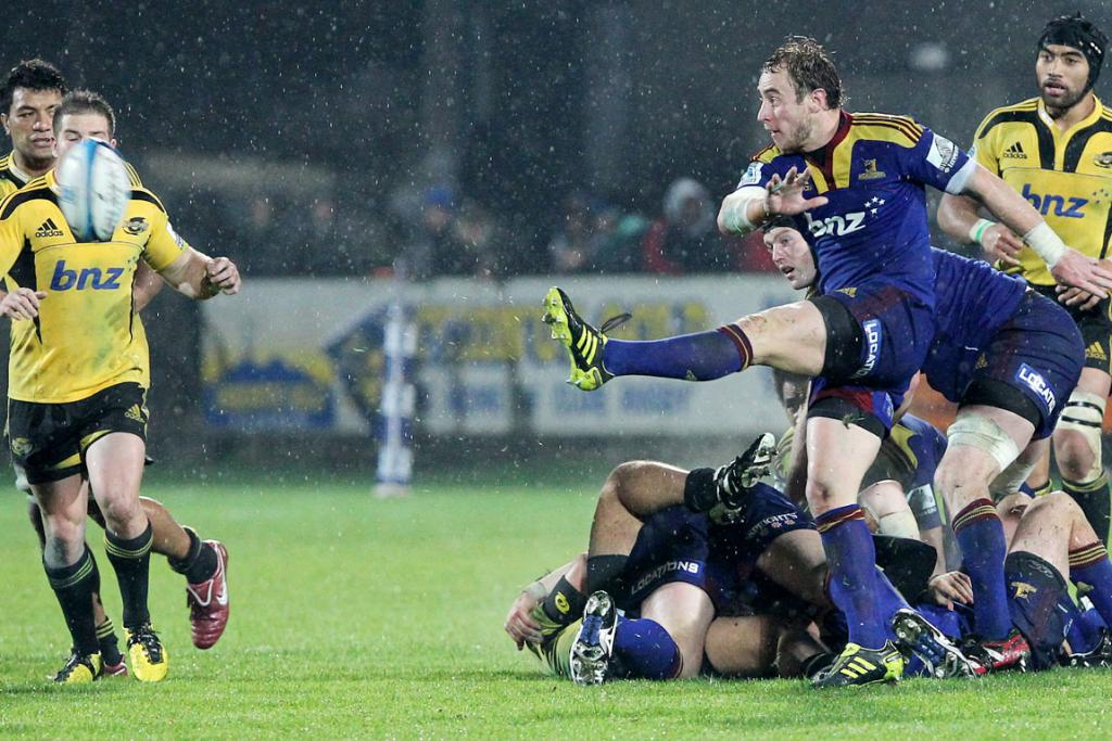 Highlanders player Jimmy Cowan kicks the ball against the Hurricanes.