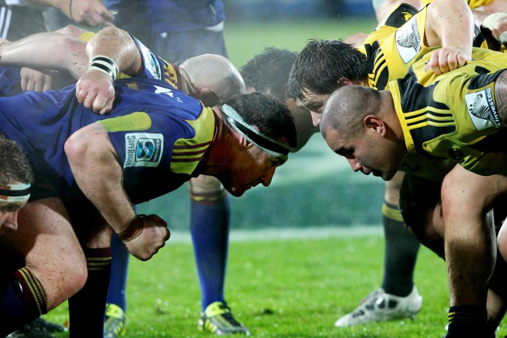 Highlanders and Hurricanes players about to engage a scrum.