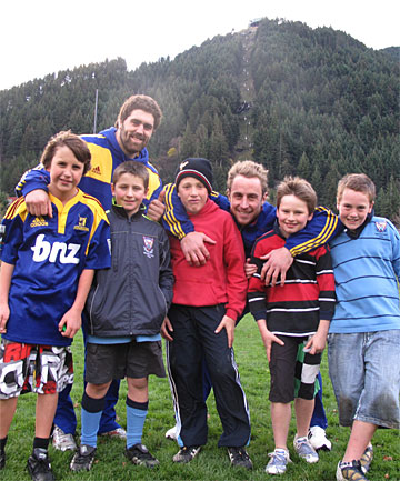 SUPER COACHES: Highlanders Jamie Mackintosh (left) and Jimmy Cowan teach their skills to Wakatipu junior rugby players (from left)  Benjamin Wiel-Lake, 11, Tom Finlin, 10, Angus Frew, 10, Will Stone, 11, and Lachie Clarke, 10.