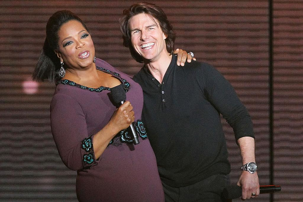 HIDE THE COUCH: Tom Cruise hugs Oprah Winfrey during her last TV show.