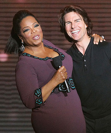 HIDE THE COUCH: Tom Cruise greets Oprah Winfrey at a farewell taping of her talk show.