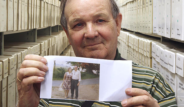 IDENTITY FOUND: George Jaunzemis, 69, who was separated from his mother in the final days of World War II, displays a photograph showing his parents.