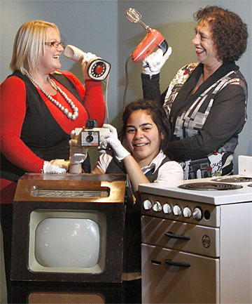EARLY GADGETS: South Canterbury Museum staff, from left, Linda Roberts, Ashton Grey and Davina Davis with some of the items that will be included in the museum's Retro Techno: Devices of Domestic Bliss exhibition, opening tonight.