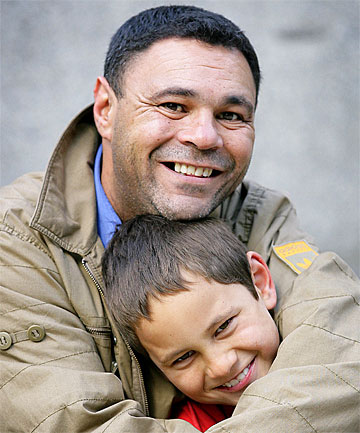 LOVING ARMS: Allan Jones with son Jacob Waikari-Jones, 7