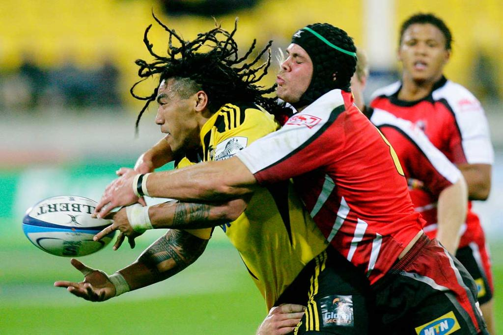Ma'a Nonu gets the pass away after being wrapped up by Warren Whiteley of the Lions.