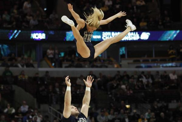 Cheerleaders of the world.Notre Dame University cheerleaders perform during the third round NCAA basketball game against Florida State University in Chicago, Illinois,