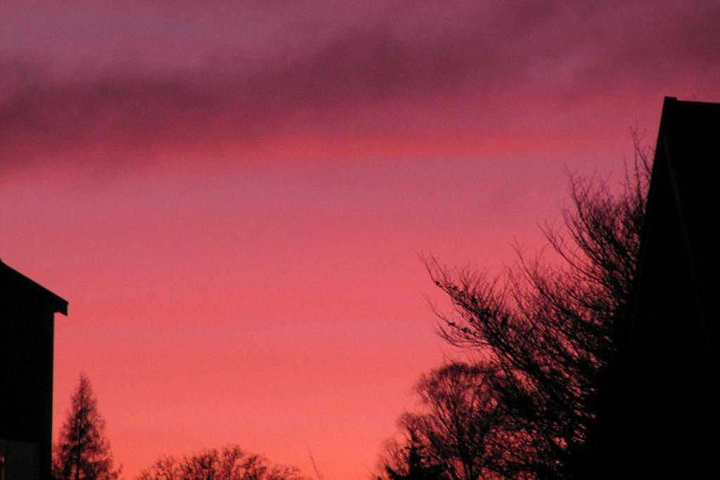 RED GLOW: Glen from Wanaka took this striking photo of Sunday morning's sunrise affected by ash.