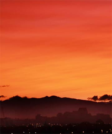 RED SKY: Sunset as seen from the top of the Woolston fire brigade training tower in Christchurch last night. The sunset was deep red because of particles in the air from a volcanic eruption in Chile.