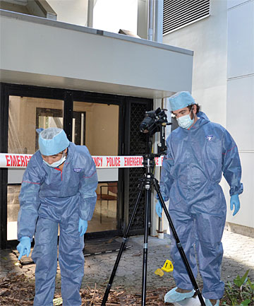 ON THE JOB: ESR forensic scientists collect photographic evidence for the new software, which will help juries visualise crime scenes.