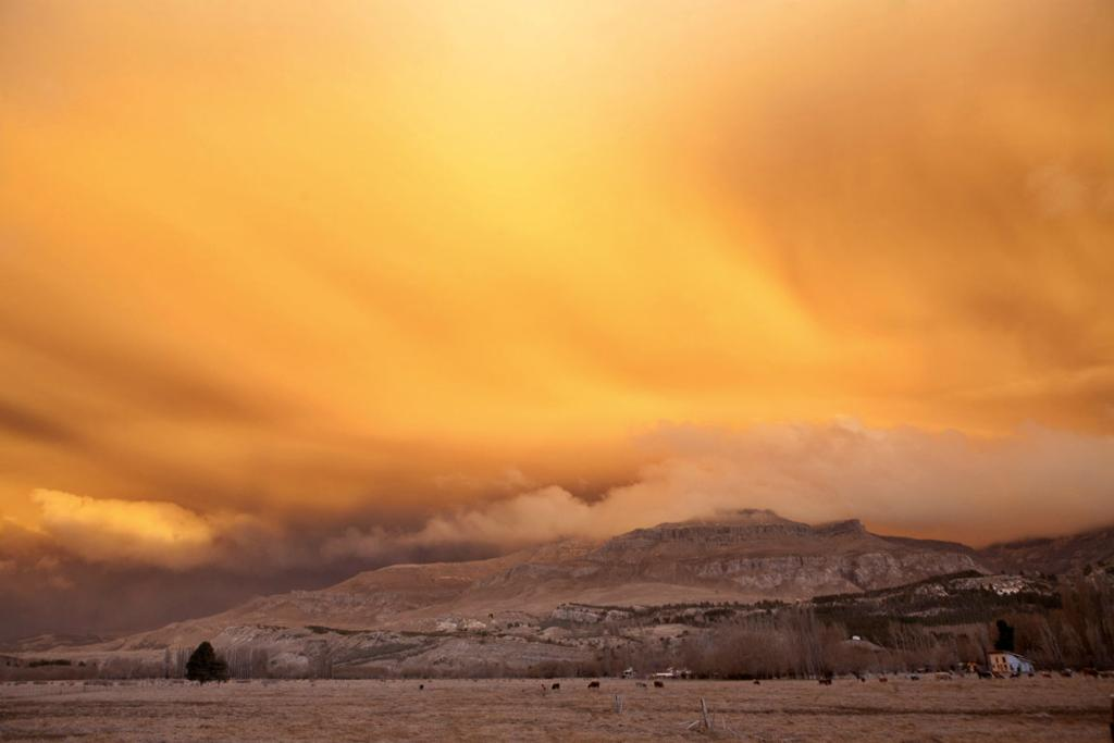 A view is seen of a cloud of ash from Chile's Puyehue-Cordon Caulle volcano chain near sunset at the mountain resort San Martin de Los Andes in Argentina's Patagonia.