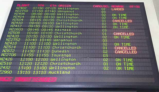Cancelled flights on the Auckland airport information board.