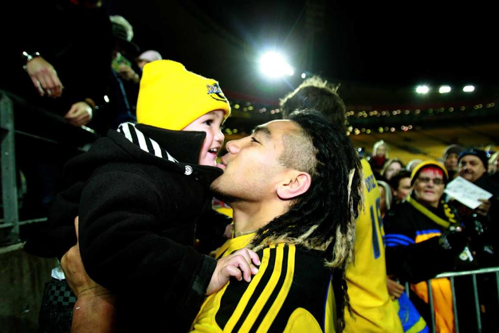 Hurricanes player Ma`a Nonu and his son Mercury after the game.
