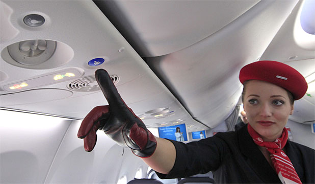 RADICAL CHANGE: An airberlin stewardess shows the new call button in the Boeing 737.