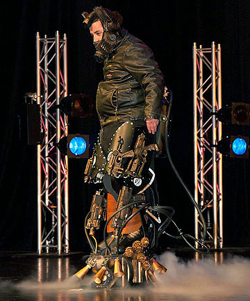 BRONZE BLING: Damien McNamara and his Exo Legs he created for Steampunk Fashion show.