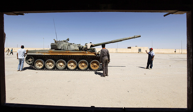PREPARING FOR BATTLE: Rebels train on a captured Gaddafi army tank in the city of Zintan on Sunday.
