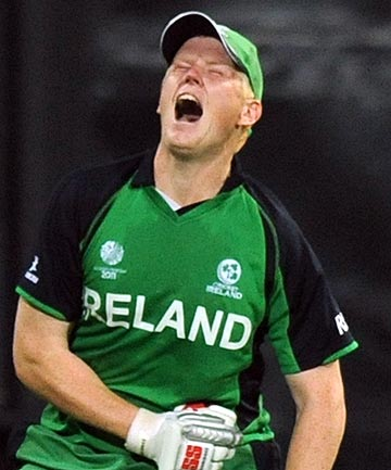 Ireland's Kevin O'Brien celebrates hitting the fastest cricket World Cup century as his side upset England.
