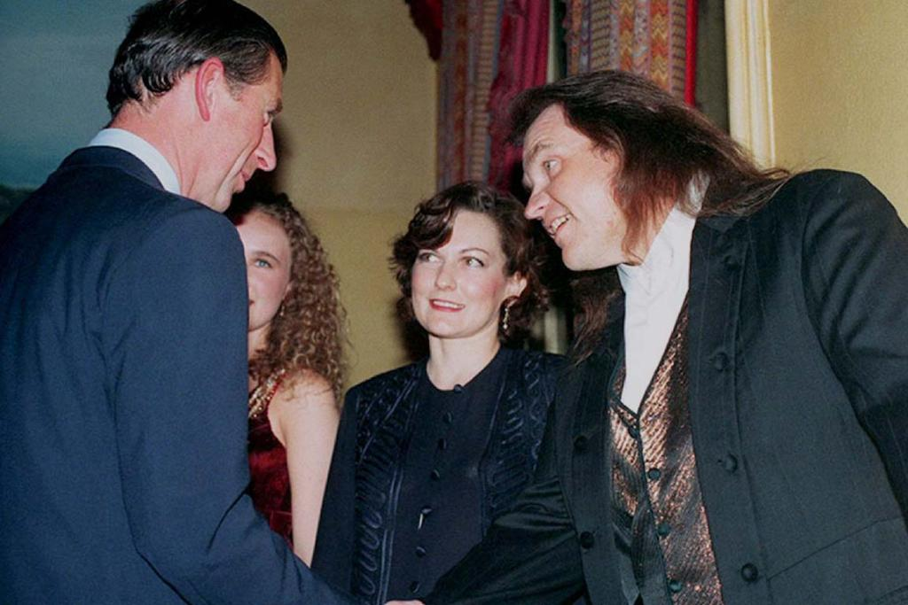 ROYAL ROCKER: The Prince of Wales shakes hands with singer Meat Loaf watched by his wife Lesley before a concert in aid of the Prince's Trust at the Royal Albert Hall November 17, 1994.