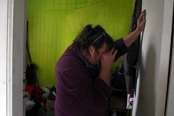 RED ZONE: Raewyn Iketau has been living in Peterborough St since the earthquake with no power or water. Showings signs of, stress and fatigue while shifting out of her house.