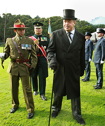 STATELY ATTIRE: Tonga's King George Tupou V inspects the guard of honour at  Government House in Wellington during yesterday's state welcome.