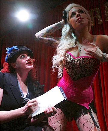 ARTISTIC EXERCISE: Rachel Rouge makes sure she  gets the composition right with her drawing of model Venus Starr at  Dr Sketchy in Wellington.