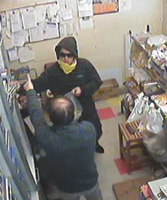 Image from the robbery that happened at the Maeroa Superette, on the corner of Maeroa Rd and Rimu.