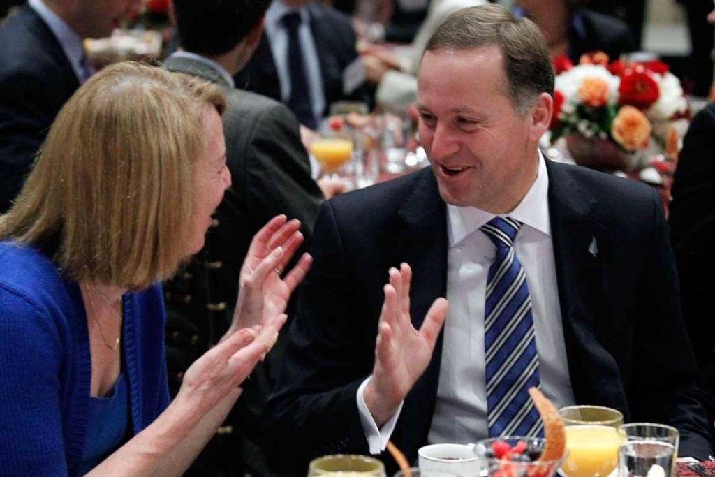 Prime Minister John Key speaks with Carol Melton, Executive Vice President for Global Public Policy of Time Warner Inc., at breakfast at the US Chamber of Commerce.