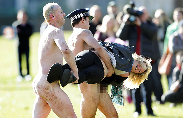 "RUDELY INTERRUPTED: A ""streaker"" intterrupts the traditional nude rugby game at Dunedin's Logan Park today."
